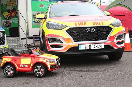 Fire officer stand little car